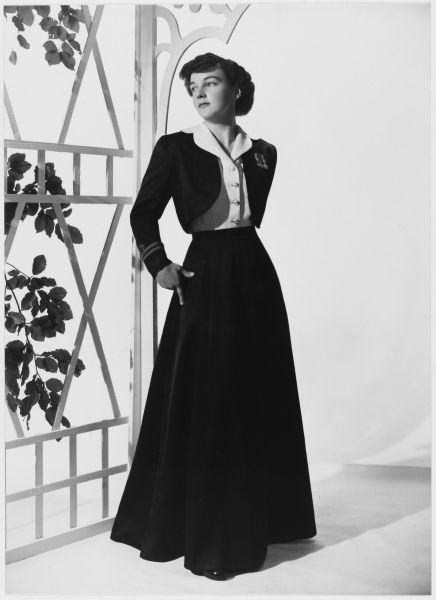 A design by Victor Stiebel for WRNS (Women's Royal Naval Service) officer's mess undress, comprising of a long skirt, blouse with revered collar and bolero jacket