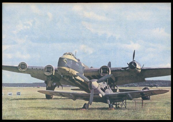 A Messerschmitt 109 poses before the British Short Stirling bomber it brought down - it has lost three of its engines - and the fourth looks fairly dodgy too !