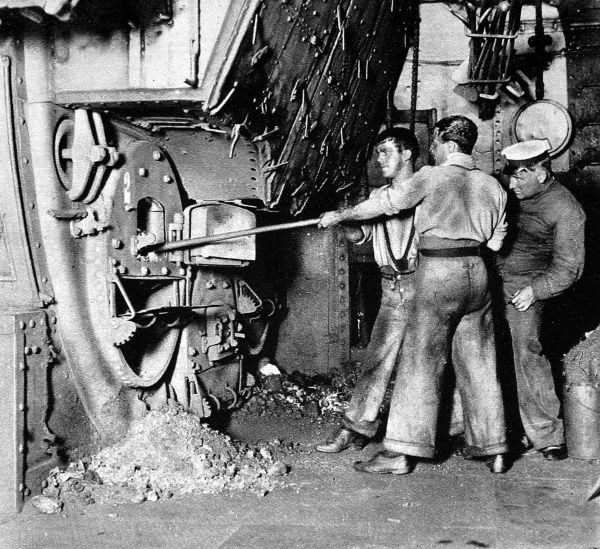 Photograph of stokers working in the stoke-hold of a British Warship, 1913