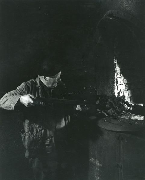 A foundryman stoking the foundry furnace at Dinorwig (or Dinorwic) Slate Quarry, near Llanberis, North Wales