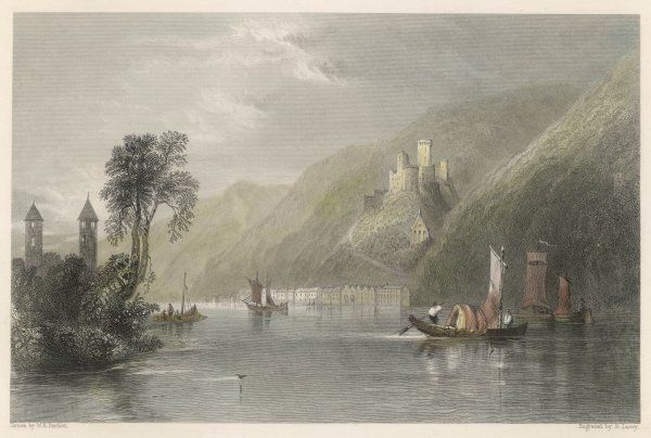 Stolzenfels, an ancient robber-fortress on the Rhine. Small river craft with sails (barges) make their way on the river