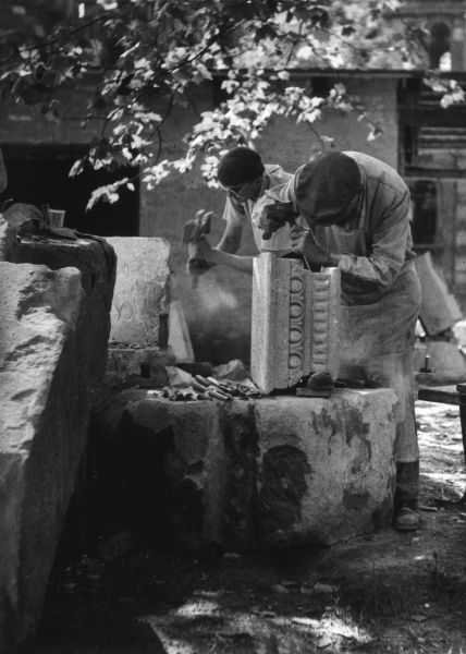 Stone cutters at work. Date: 1930s