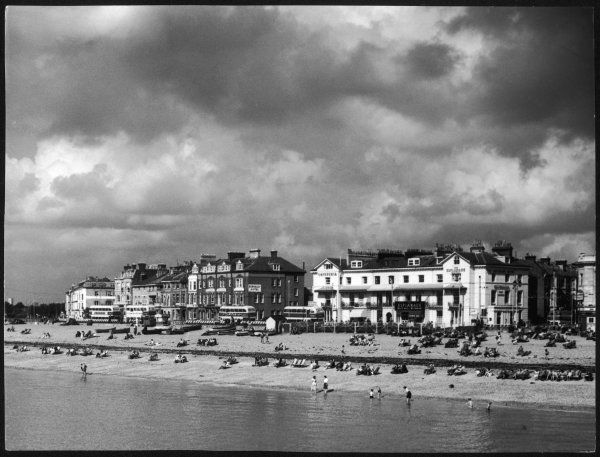 Storm clouds over the promenade and the beach, from the pier at Southsea, Hampshire, England