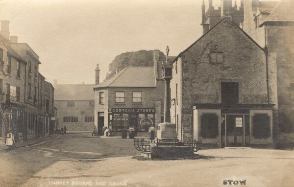 Stow-on-the-Wold, Cheltenham, Gloucestershire - The Market Square and Cross. The 16th century courthouse (centre right) was demolished in 1901. Date: circa 1900