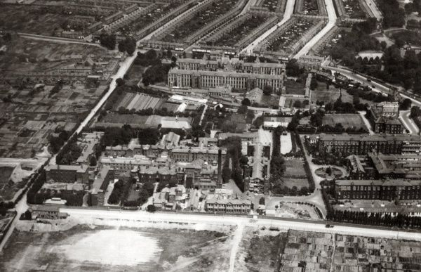 An aerial view of the Strand Union workhouse (above centre) and Edmonton Union workhouse (below centre) at Edmonton, Middlesex. The buildings at the lower right corner are an infirmary complex erected in 1910 and used as a military hospital in World War One