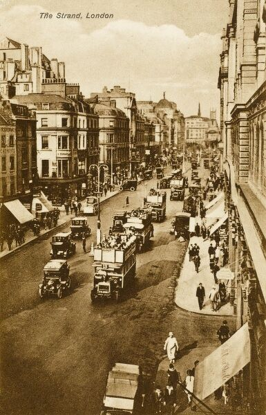 A view of The Strand, London with a number of open-top omnibuses