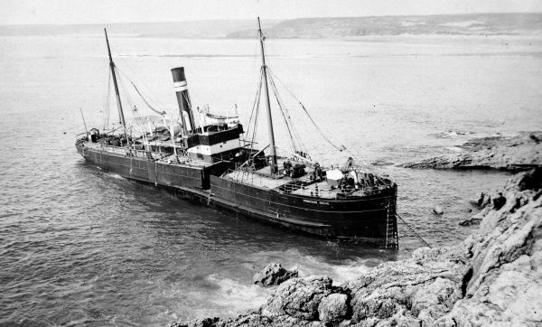 View of a stranded steamship, the Princess Irene, on the coast at Linney Head, Pembrokeshire, South Wales. Shortly after leaving Aberdeen the ship met foggy weather and steered to Linney Head, where she became stranded on 29 August 1906