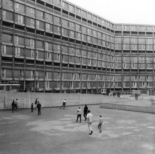 Children play football outside their council flats in Sheffield Date: 1966