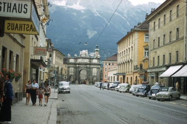 A street scene in Innsbruck in Tyrol, western Austria. A mother and her three daughters walk along the street. (2 of 2)