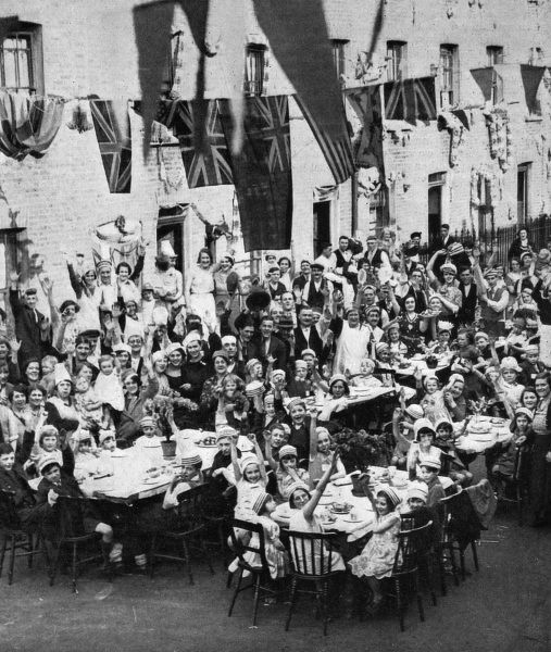 A street tea-party in Battersea, London, celebrating the Silver Jubilee of King George V. 1935