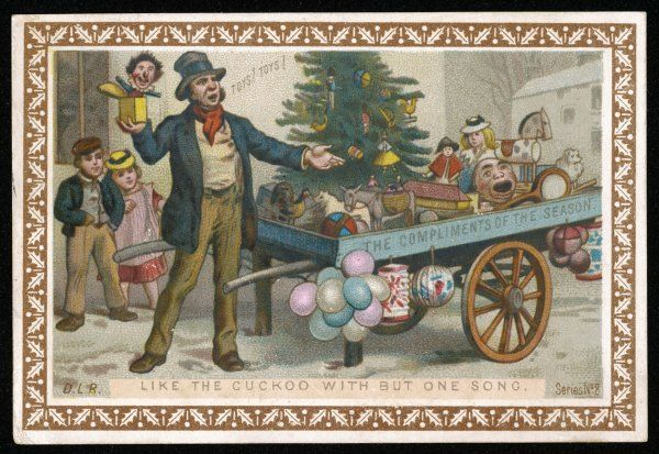 A street seller offers Christmas toys from his cart