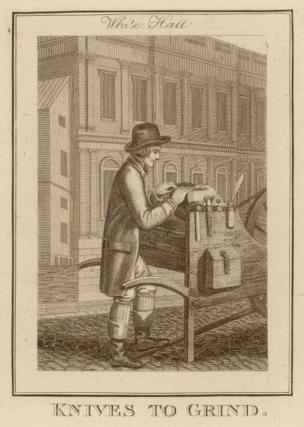 A grinderx sharpens a knife in Whitehall, London