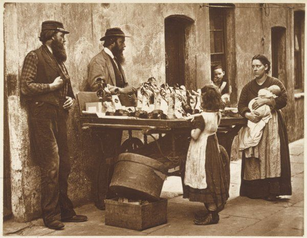 "Two men dealing in ""fancy ware"" attract the interest of a young mother and her daughters"