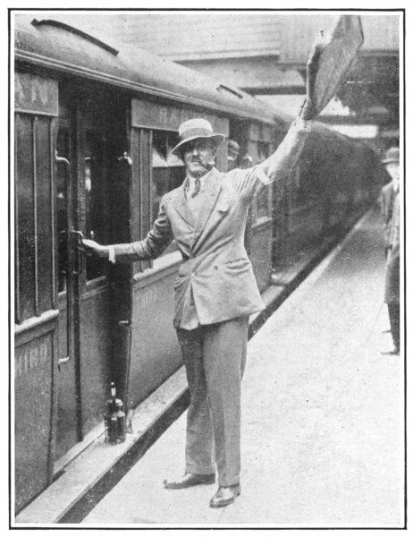 A volunteer acts as a guard on a train during the General Strike