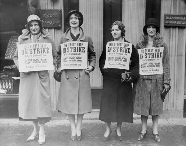Four women workers from 'The Beauty Shop', on strike for decent living wages and decent working hours. Date: early 1930s