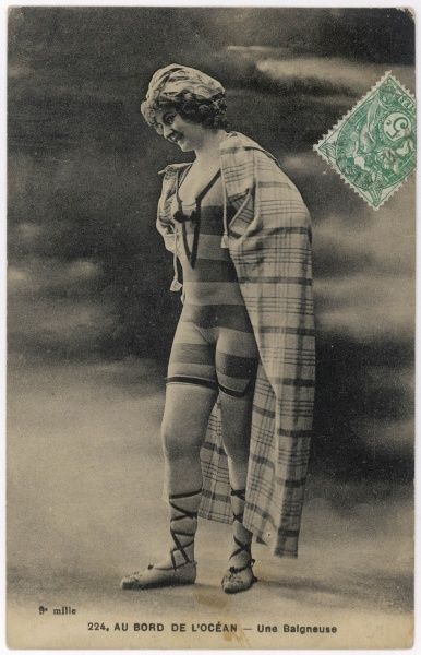 Edwardian bathing beauty in a striped one-piece bathing costume & espadrilles with embroidered linen uppers & ribbon lacing