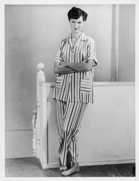 A young woman with stylish short hair wears a pair of short-sleeved pyjamas - a feminine version of the classic men's striped p.j's