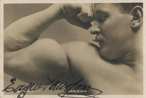 EUGEN SANDOW American exponent of physical fitness, showing off his arm muscles