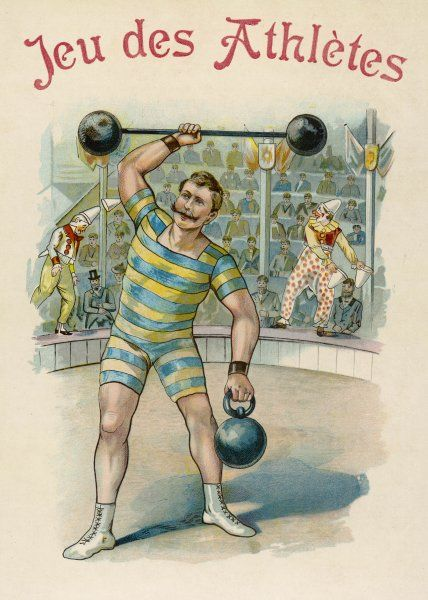 A strong man wearing a blue and yellow striped outfit lifts heavy weights in a circus ring, while clowns entertain the audience in the background