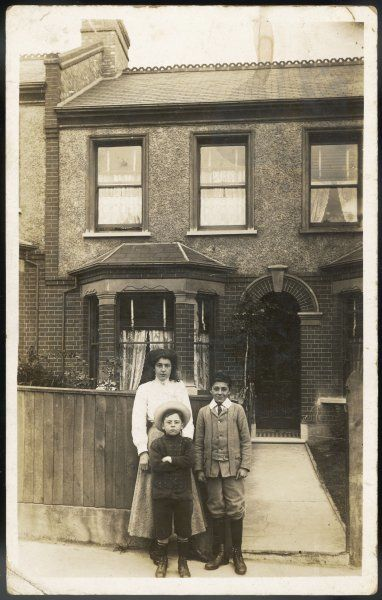 Cissie poses with her two boys at the front gate of their Dulwich home : presumably papa is taking the picture