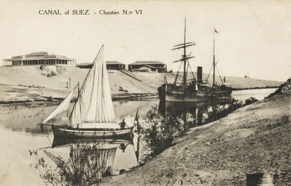 A fine view of the Suez canal, showing the old and the new; a large transport steamship and a traditional small sailing boat