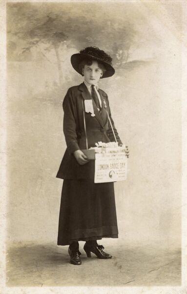 Suffragette selling badges Date: circa 1910s