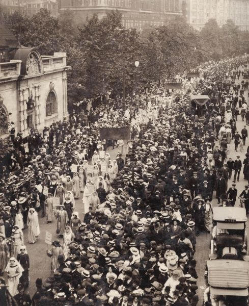 A large suffragette procession passing along the Embankment in Central London