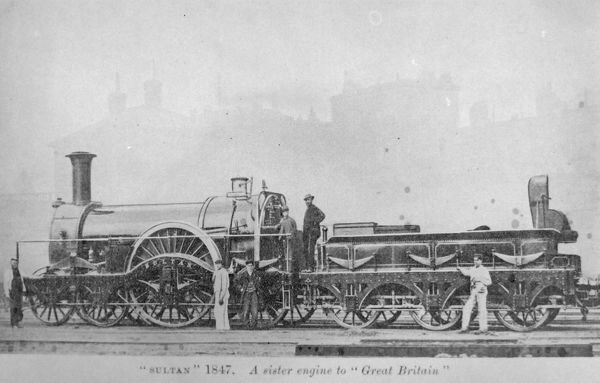 The newly built Sultan locomotive, belonging to the Iron Duke class of the Great Western Railway, a sister engine to the Great Britain. Both were built in 1847. Six railway workers pose with the engine