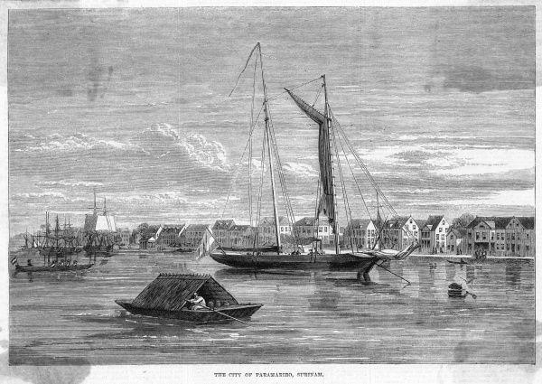 The principal city of Suriname (formerly Dutch Guiana), with a native boat in the harbour
