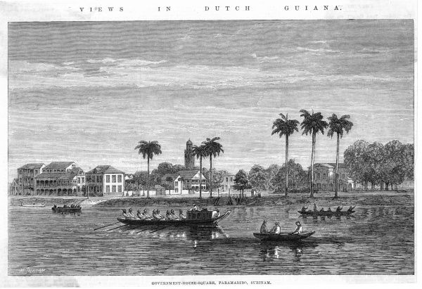 Government House and its square in the principal city of Suriname (formerly Dutch Guiana) with various native boats