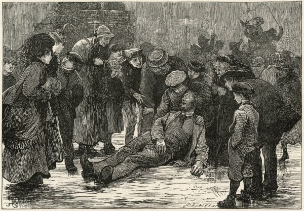 A drunken man lying in the street attracts a crowd of onlookers, who attempt to revive him