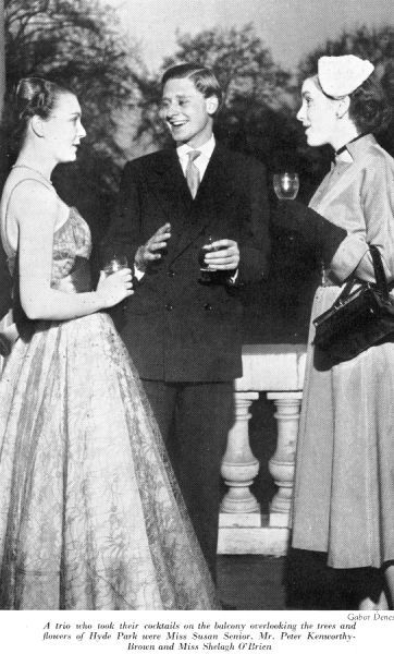 Miss Susan Senior, Mr Peter Kenworthy-Browne and Miss Shelagh O'Brien drinking cocktails on the balcony overlooking Hyde Park