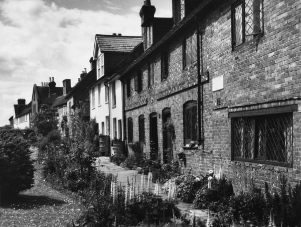 A charming row of cottages in the pretty village of Cowfold, Sussex, England