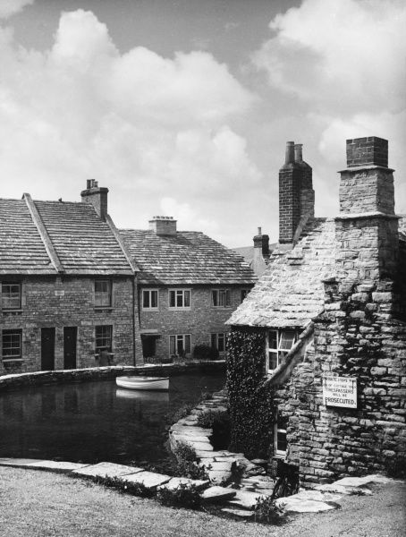 SWANAGE A group of stone cottages round a mill pond