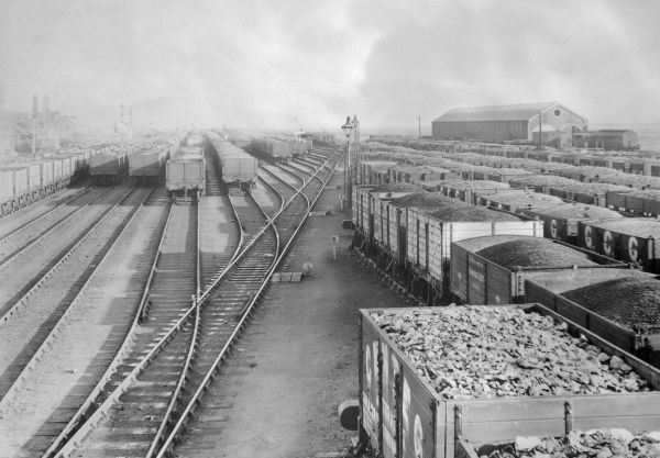 View of Swansea's main railway sidings on the Great Western Railway in Glamorgan, South Wales, with a large number of loaded trucks