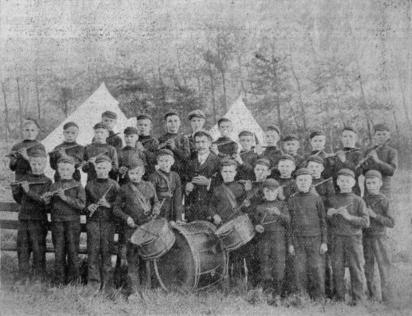 The camp band formed at a gathering of boys from the Swansea Poor Law Union Schools and Swansea Industrial Schools. Date: 1906