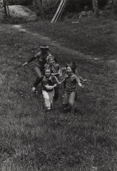 A group of Swedish Beaver Scouts and leader playing a chasing game.  circa 1980s