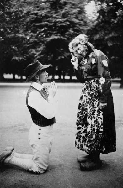 A young man kneels down and makes a declaration of undying love to a fair maid during a traditional Swedish clog dance! Date: 1930s