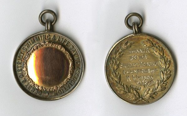Medal of the Derby & District Swimming & Life Saving Association, awarded to K. W. Watson for winning the 100 Yards Breast Stroke Championship. Date: 1932