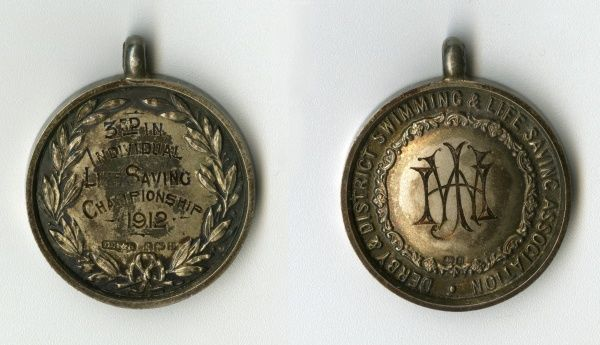 Medal of the Derby & District Swimming & Life Saving Association, awarded to JHW (J. H. Watson) for coming 3rd in the Individual Life Saving Championship. Date: 1912
