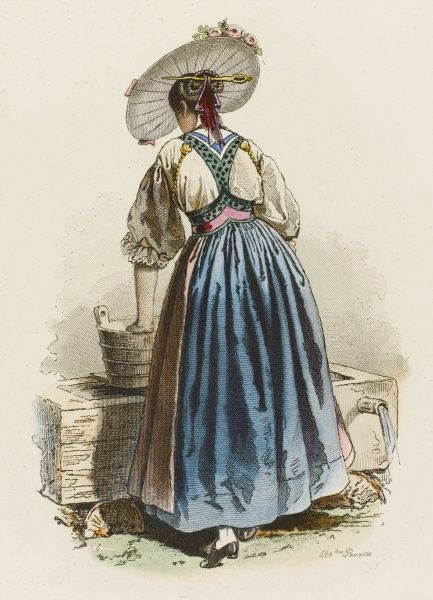 A young woman from the canton of Unterwald wears her picturesque regional costume while she does some laundry