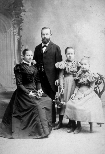 Two well-behaved Swiss sisters pose with their parents Date: 1897