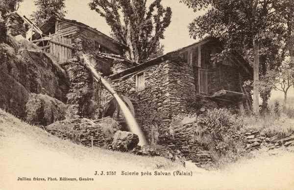 Switzerland - Overshot Watermill near Salvan. The directed water jet has been temporarily moved away from the wheel whilst the mill is taken out of operation. In the Valais region. Date: circa 1910s