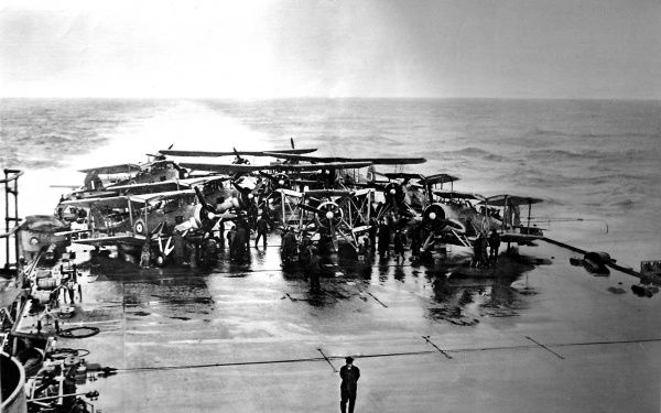 Photograph showing Fleet Air Arm 'Swordfish' torpedo-bombers gathered on the stern of the Royal Navy aircraft-carrier HMS 'Victorious', during the Second World War, 1941