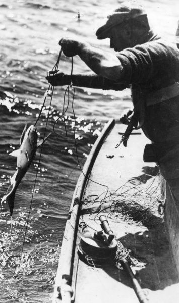 This fisherman has caught a swordfish! Date: 1930s
