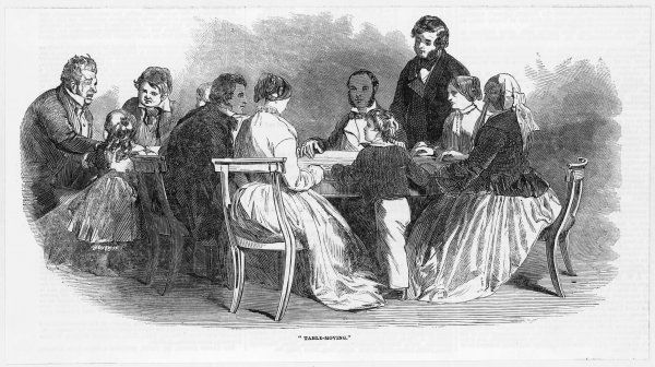 A table-moving seance en famille during the early days of spiritualism