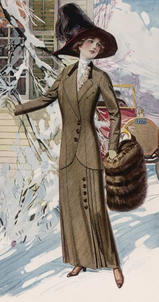 Tailor-made suit: button detailing, box pleated skirt & long line jacket with velvet collar & western style pocket, a blouse with lace jabot, broad brimmed hat & fur muff
