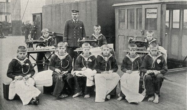 Boys taking part in a tailoring class on the Training Ship Wellesley, on the River Tyne at North Shields, Northumberland