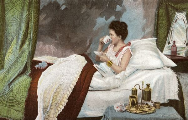 A well-to-do lady takes her breakfast coffee in bed. She has an elaborate coffee machine / percolator on her bedside table! Date: 1905