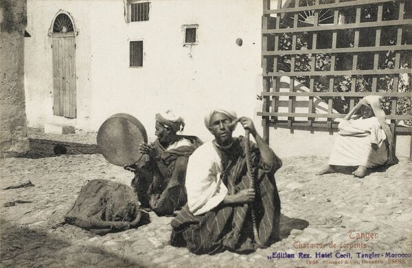 Tangiers, Morocco - Street snake Charmer and musician with a Bendir Frame Drum
